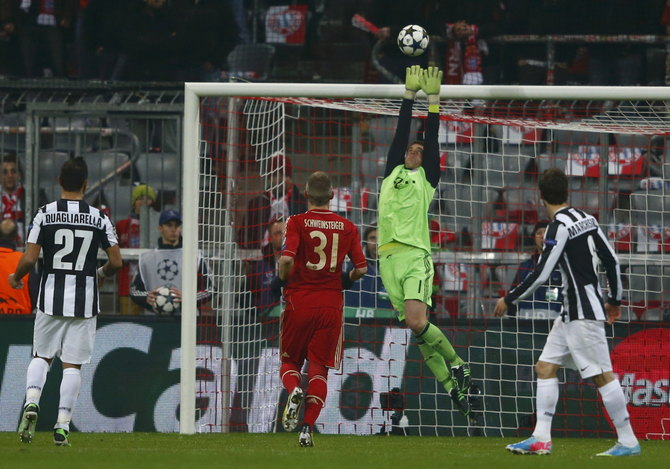 Bayern Munich's goalkeeper Neuer saves a shot during their Champions League quarter-final first leg soccer match against Juventus' in Munich