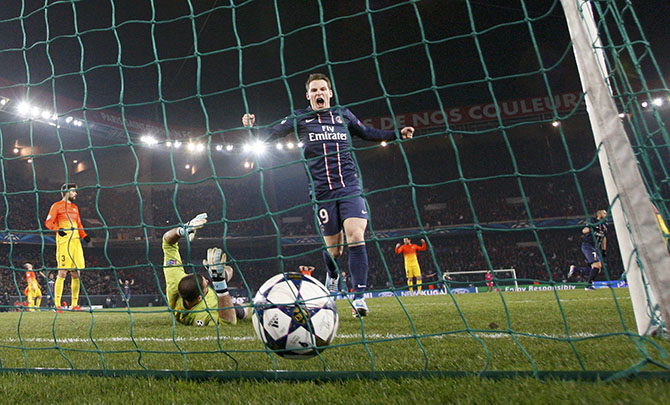 Paris St Germain's Gameiro celebrates after Blaise Matuidi (not pictured) scored against Barcelona during their Champions League quarter-final first leg soccer match at the Parc des Princes Stadium in Paris