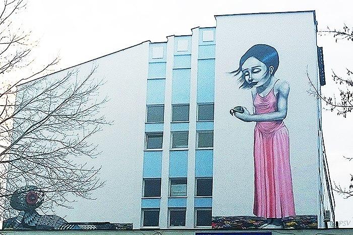 «Здорово, что можно смотреть не на бетонную стену, а на что-то яркое». Каково жить минчанам в квартирах с видом на граффити? 14